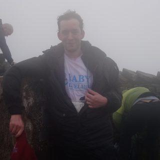 fundraising-hero-battles-wind-and-rain-to-scale-2-peaks